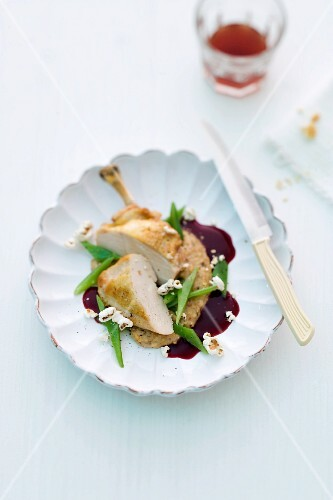 Guinea fowl on polenta with a red wine sauce