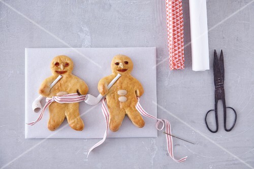 Bread men with pipes and stripped ribbon for Christmas