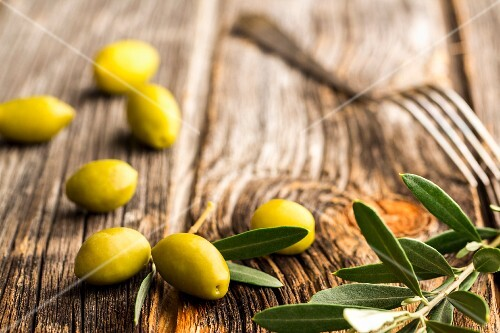 Fresh olives on a wooden surface