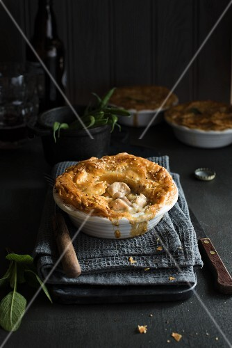 A chicken and mushroom pie in a white baking dish
