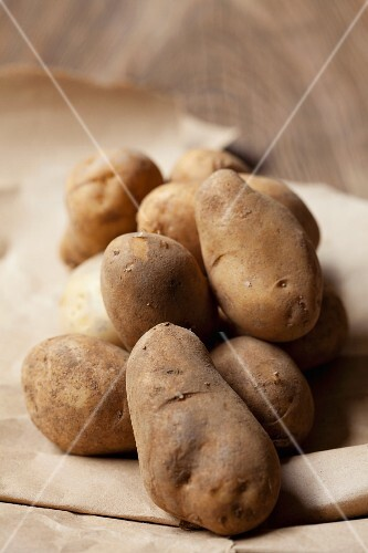 New Charlotte potatoes on brown paper