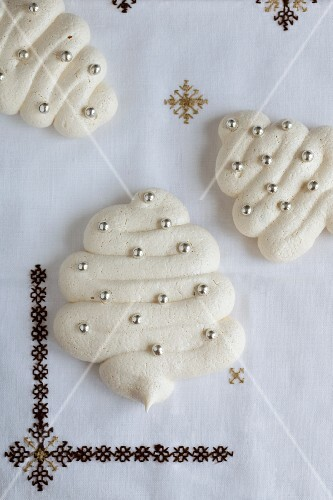 Christmas meringues decorated with silver pearls