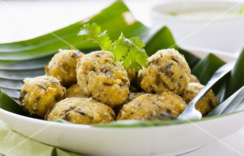 Steamed lentil balls on a banana leaf
