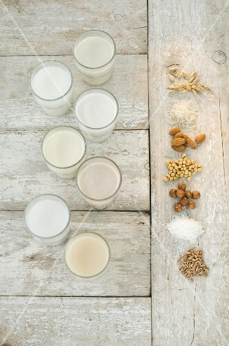 Various types of lactose-free milk in glasses (seen from above)
