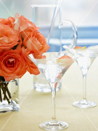 A rose Martini with a bunch of salmon-pink roses