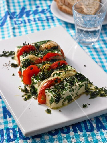 Oven-baked feta cheese with tomatoes and herbs