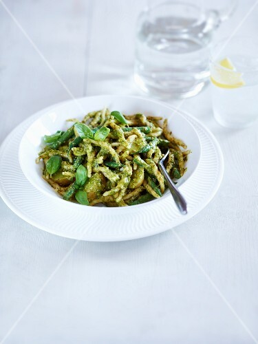 Spätzle (soft egg noodles from Swabia) with pesto and fresh basil