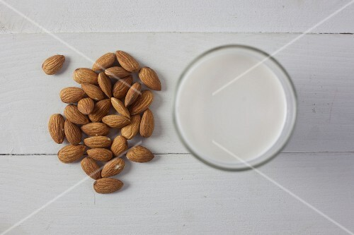 Almonds and a glass of almond milk