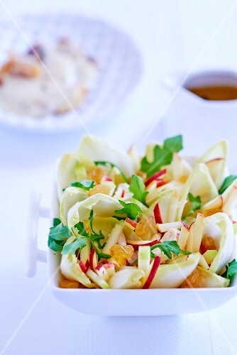 Chicory salad with apple, rocket and sultanas