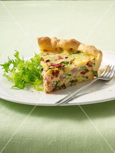 A slice of ham, rocket and goat's cheese quiche