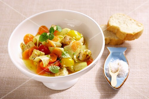 Warm vegetable salad with pangasius