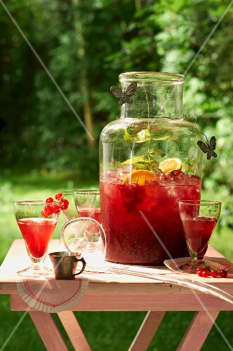 Redcurrant iced tea on a table outside