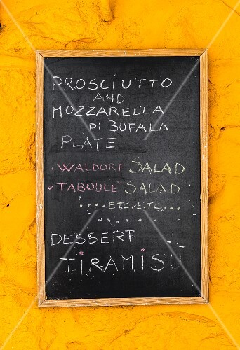 A specials board on a yellow wall