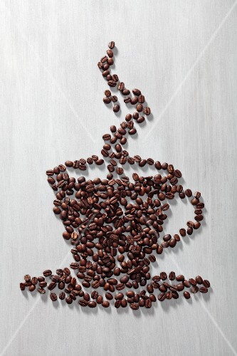 Coffee beans arranged in shape of coffee cup