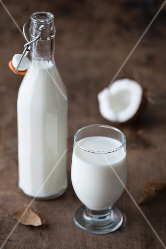 Coconut milk in a glass and in a bottle