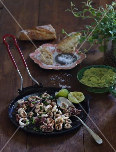 Squid with chilli, limes, grilled parsley and guacamole