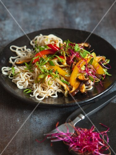 Vegan mie noodles with colourful stir-fried vegetables and shiitake mushrooms
