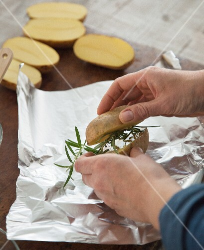 Rosemary potatoes being prepared for grilling