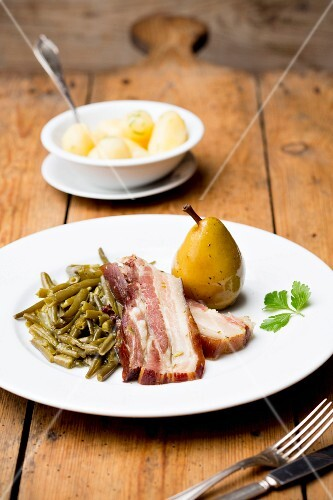 Bacon with beans, a pear and salted potatoes