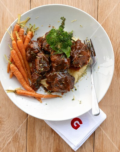 Oxtail ragout on mashed potatoes and parsnips with carrots