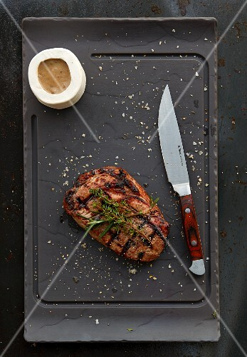 Grilled ribeye steak with sauce