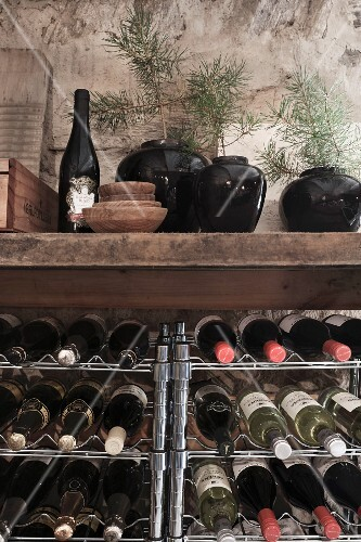Christmas in a wine cellar: a wine rack decorated with pine sprigs