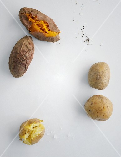 Various types of oven-baked potatoes (seen from above)