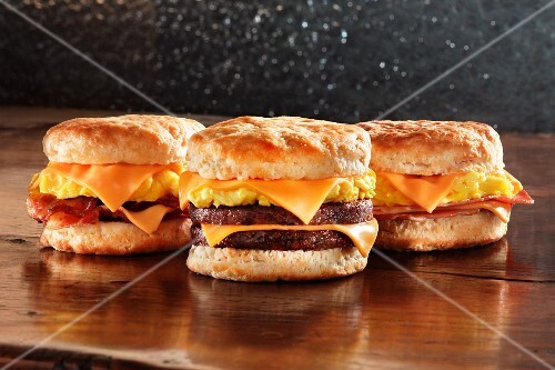 Scrambled eggs, cheese, bacon, sausage or ham on American biscuits