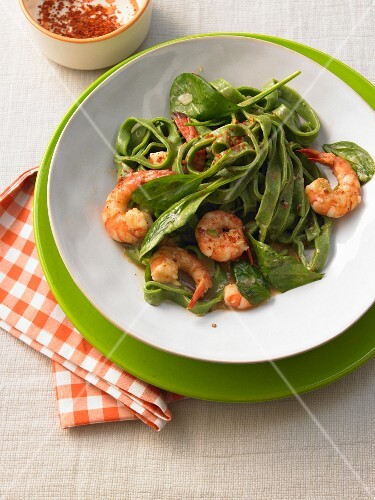 Grass green pasta with spinach and prawns