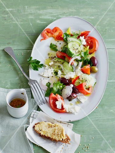 Greek salad with pea cream crostini