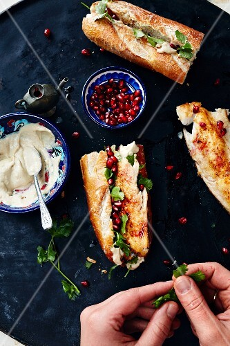 Galata trout rolls with tahini sauce and pomegranate seeds (Turkey)