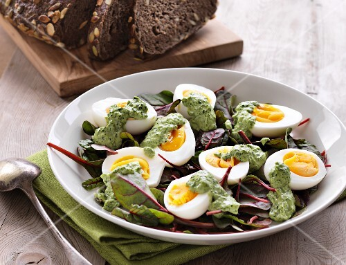 Boiled eggs with herb mayonnaise on lettuce