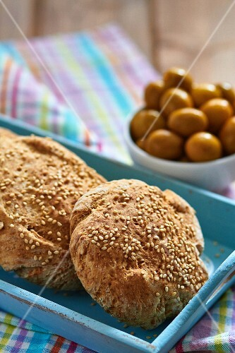 Sesame seed rolls and olives