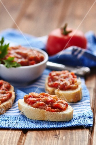 Aubergine caviar on slices of baguette
