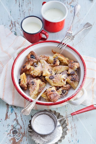 Kaiserschmarrn (shredded sugared pancake from Austria) with rum-soaked and icing sugar