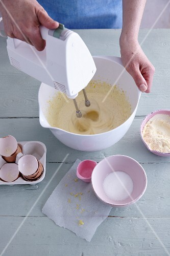 Ingredients for gluten-free sponge cake being mixed together