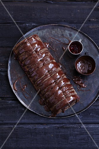 Gluten-free chocolate log cake with chocolate glaze