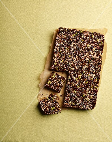 Homemade muesli bars with quinoa, seeds, wild rice and chocolate