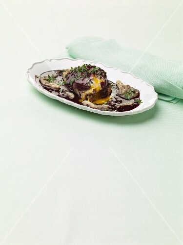 Oeufs en meurette (eggs in a red wine sauce) with mushrooms