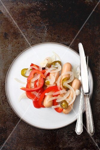 Utopenci (sausages pickled with onions and peppers, Czech Republic)