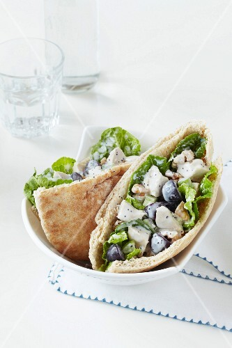 Chicken salad with grapes and walnuts in pita halves