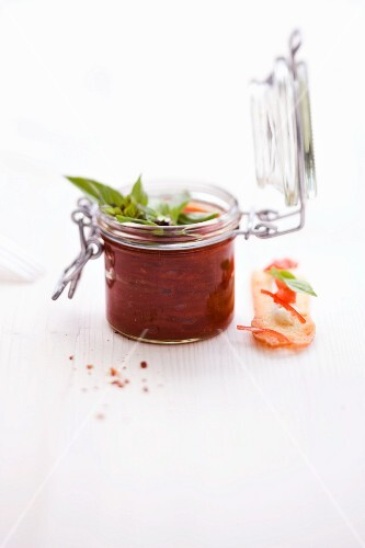 Oven-baked tomato and chilli verrine with basil butter crostini