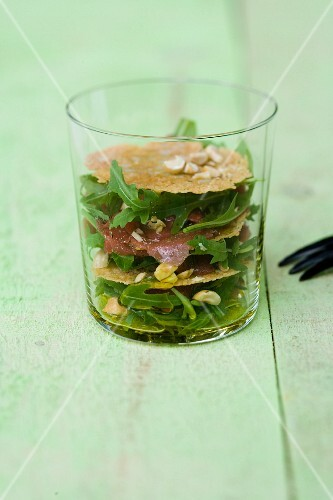Beef fillet carpaccio with hazelnuts, Parmesan crisps and rocket in a glass