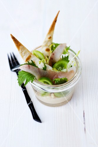 Liquorice smoked swordfish with hummus, green tomatoes and crispy unleavened bread in a glass