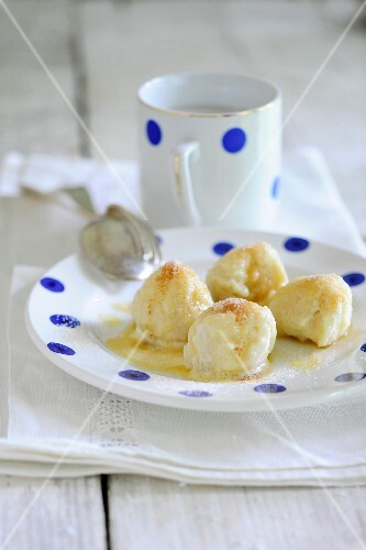 Quark dumplings with buttered crumbs