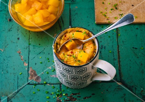 Sweet and sour mug cake with pumpkin, processed cheese and chives