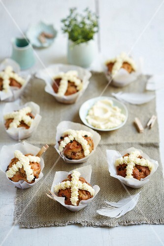 Hot cross bun muffins decorated with cream cheese for Easter
