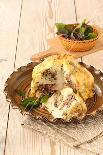 Stuffed gratinated cauliflower, sliced