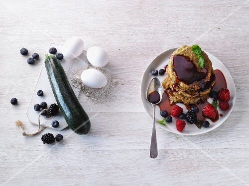 Courgette pancakes with date syrup and fresh berries