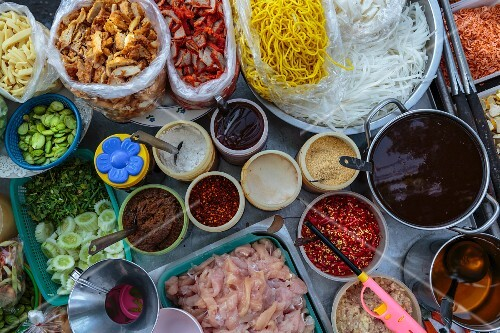 Ingredients for various dishes at a fast food stand, Bangkok, Thailand